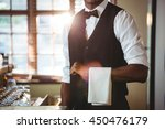 mid section of bartender with... | Shutterstock . vector #450476179