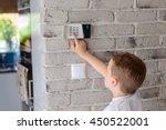 little baby boy pushes a... | Shutterstock . vector #450522001