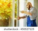 windows installation worker. | Shutterstock . vector #450527125