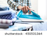closeup of woman ironing... | Shutterstock . vector #450531364