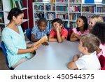teacher reading a book to...   Shutterstock . vector #450544375