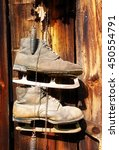 Small photo of antique old style retro object assemblage on a wooden wall, rustic stile. Old skates.