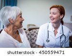 happy doctor and patient at home | Shutterstock . vector #450559471