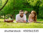 couple lying on a picnic... | Shutterstock . vector #450561535