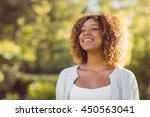 beautiful woman smiling on a... | Shutterstock . vector #450563041