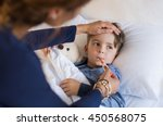 sick boy with thermometer... | Shutterstock . vector #450568075