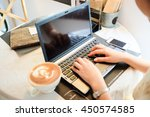 close up hand girl with coffee... | Shutterstock . vector #450574585