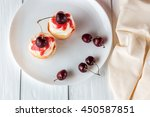 Cupcakes With Cherries On Plat...