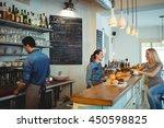 happy female barista... | Shutterstock . vector #450598825