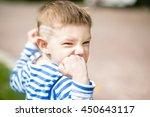 little boy in a striped t shirt ... | Shutterstock . vector #450643117