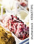 Small photo of mixed colourful organic fresh gourmet ice cream sweet gelato in shop display