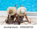 two woman in a hat sitting on... | Shutterstock . vector #450658705