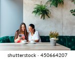 mother and daughter women using ... | Shutterstock . vector #450664207