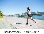 woman running at the city | Shutterstock . vector #450730015