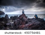 two men sit on the rocks and... | Shutterstock . vector #450756481