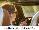 woman listen music in car | Shutterstock . vector #450762115