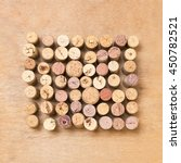 corks in square over a wood...   Shutterstock . vector #450782521
