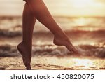 sexy woman's legs  on the sandy ... | Shutterstock . vector #450820075