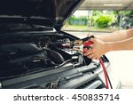 mechanic using jumper cables to ... | Shutterstock . vector #450835714