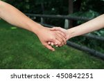 couple holding hands in the... | Shutterstock . vector #450842251