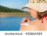 Young Woman Applying Sun Lotio...