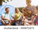 happy friends resting near river | Shutterstock . vector #450872671