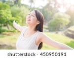 young woman raising her arms... | Shutterstock . vector #450950191
