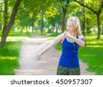 woman spraying insect... | Shutterstock . vector #450957307