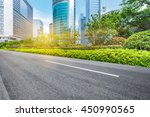 empty road front of modern... | Shutterstock . vector #450990565