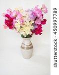 A Vase Of Sweet Pea Flowers