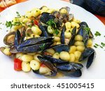 gnocchi with mussels  clams ... | Shutterstock . vector #451005415