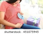 Pregnant Woman Holding Bootees...