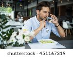 handsome man drinking water and ... | Shutterstock . vector #451167319