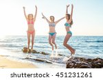 three girls having fun on beach ... | Shutterstock . vector #451231261