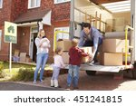 family unpacking moving in... | Shutterstock . vector #451241815
