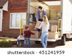 family unpacking moving in... | Shutterstock . vector #451241959