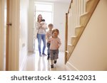 young family looking around... | Shutterstock . vector #451242031