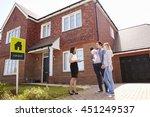 realtor outside house for sale... | Shutterstock . vector #451249537