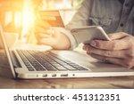 online payment man's hands... | Shutterstock . vector #451312351