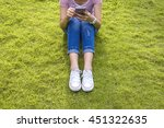 young woman use cell phone and... | Shutterstock . vector #451322635