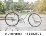 an old bike leaning beside a... | Shutterstock . vector #451383571