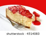 A slice of baked cheesecake topped with strawberry glaze. - stock photo
