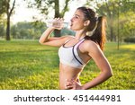 young athletic girl drinking... | Shutterstock . vector #451444981