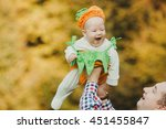 dad raised in the air his... | Shutterstock . vector #451455847