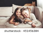 Stock photo home portrait of two cute children hugging with ginger cat and puppy of chinese shar pei dog on the 451456384