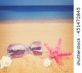 red starfish and sunglasses in... | Shutterstock . vector #451472845