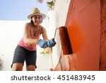 Mature Woman Painting The...
