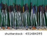 row of many used old golf clubs ... | Shutterstock . vector #451484395