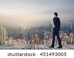 businessman hold his coat after ... | Shutterstock . vector #451493005