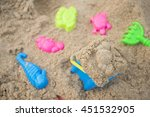Colorful Toys For Kids On Sand...